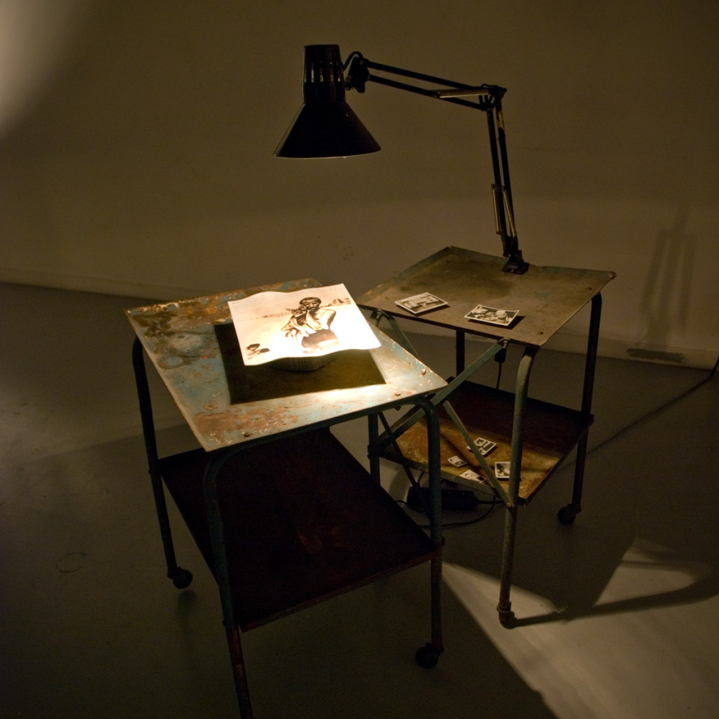 209c - Vian D'Oc (2015) shown at solo exhibition 'Jean's Cabane' at La Friche 07/15 - two old mechanic's tables, 7 phossils, angle-poised lamp, soundtrack by Vian