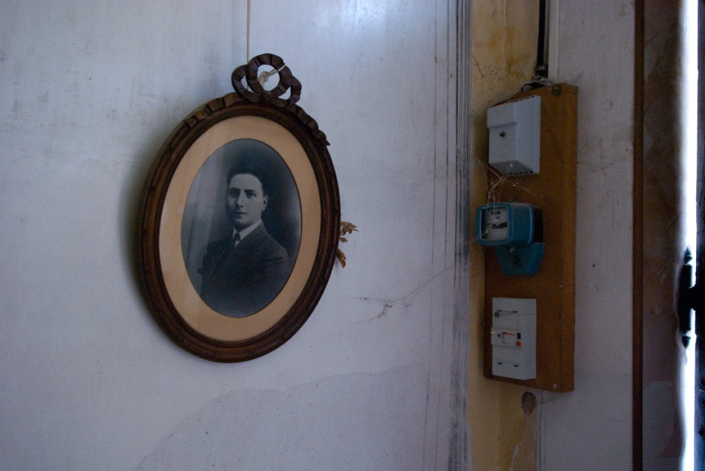 210 - Photograph taken of photographic portrait of Jean cabane in entrance porch of Quarante © Charlie Bonallack