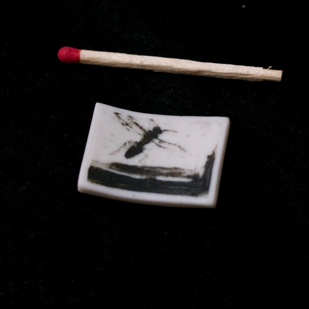 218b - Phossil 88 - Fly Landscape by Man Ray (2015) - 3.5cm x 2.5cm x 0.2cm approx.- hand-painted with pigment on porcelain, fired twice up to 1280cº